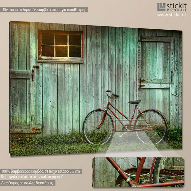 Canvas print Old bicycle leaning against grungy barn